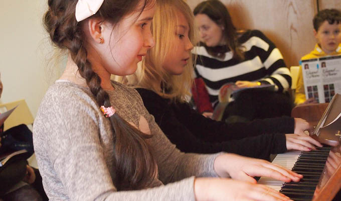 Students at the Colourful Keys Piano Studio playing a duet
