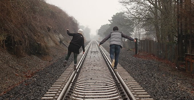 Two people on traintracks