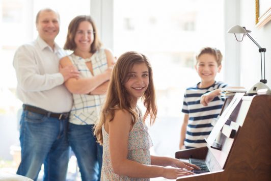 Happy young family piano