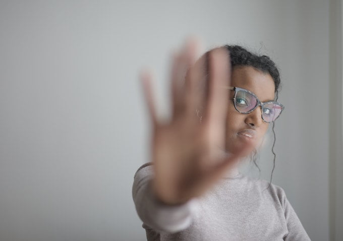 woman-doing-stop-gesture-with-palm-at-camera-3880939